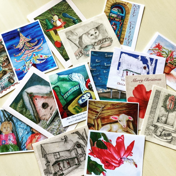 A variety of Christmas Cards displayed on a table top.