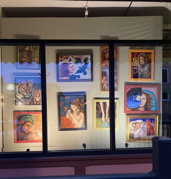 Original paintings displayed an a lighted window