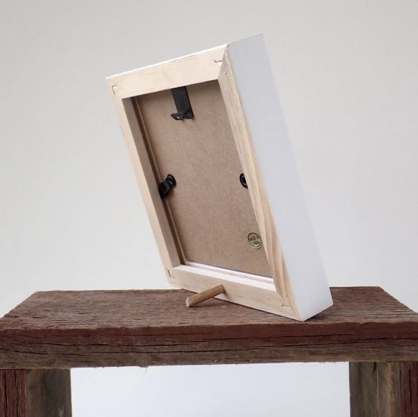 The back of a white Tiny Wonder Frame