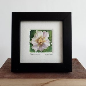 A four by four framed original tiny watercolor painting of a potato flower.
