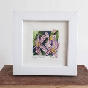 A tiny original watercolor painting of eggplant blossoms
